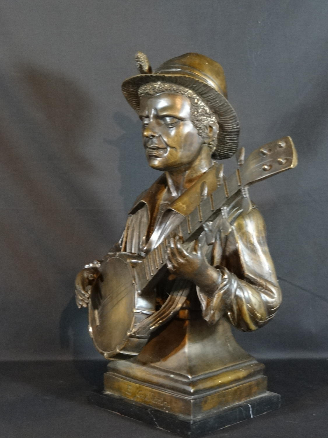 Bronze guitar man