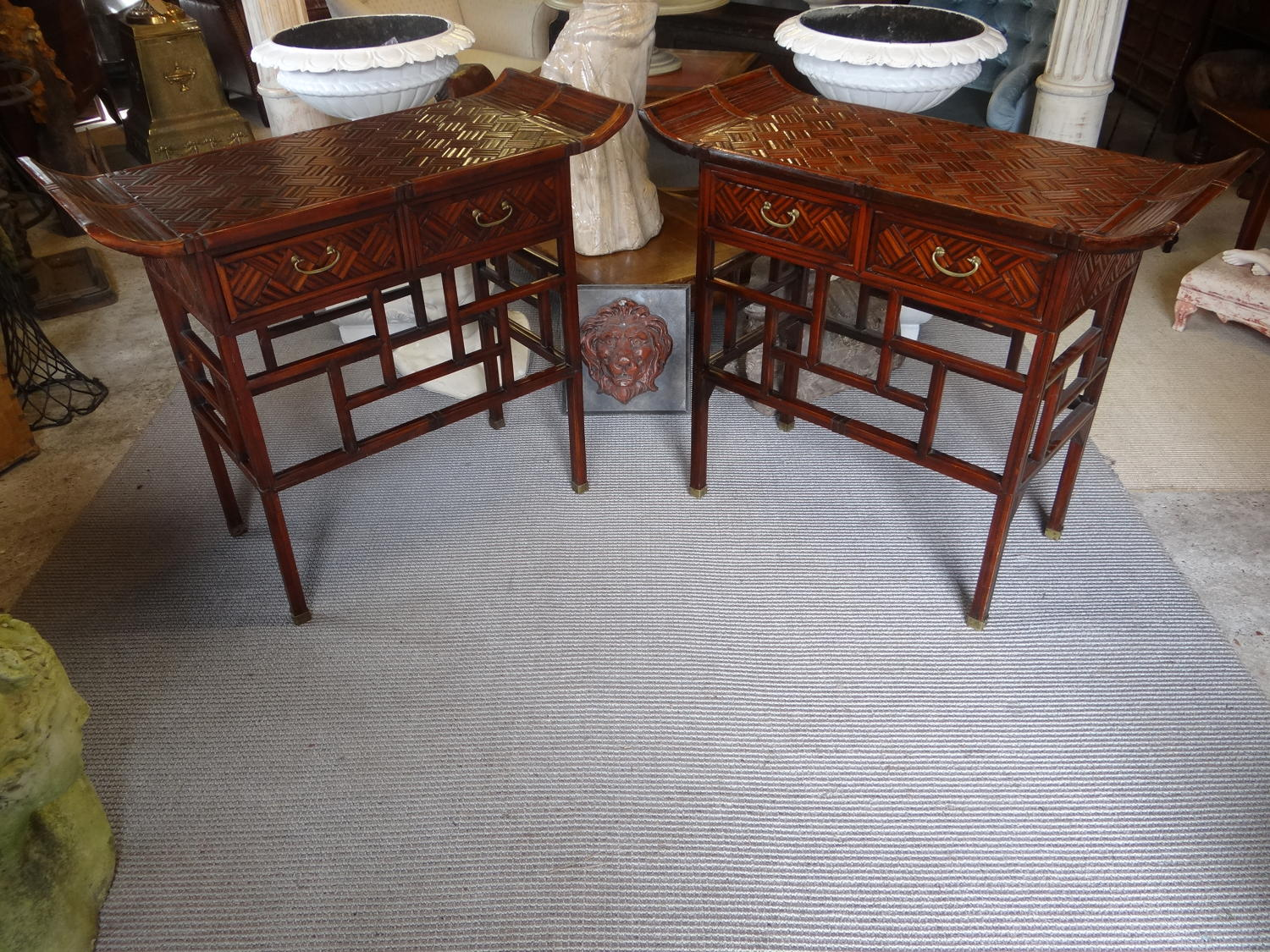 A pair of Chinese side tables.