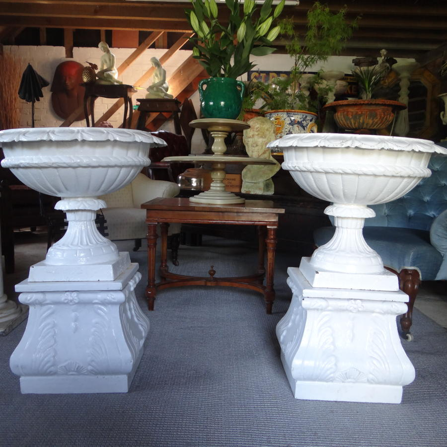 19th century cast iron urns