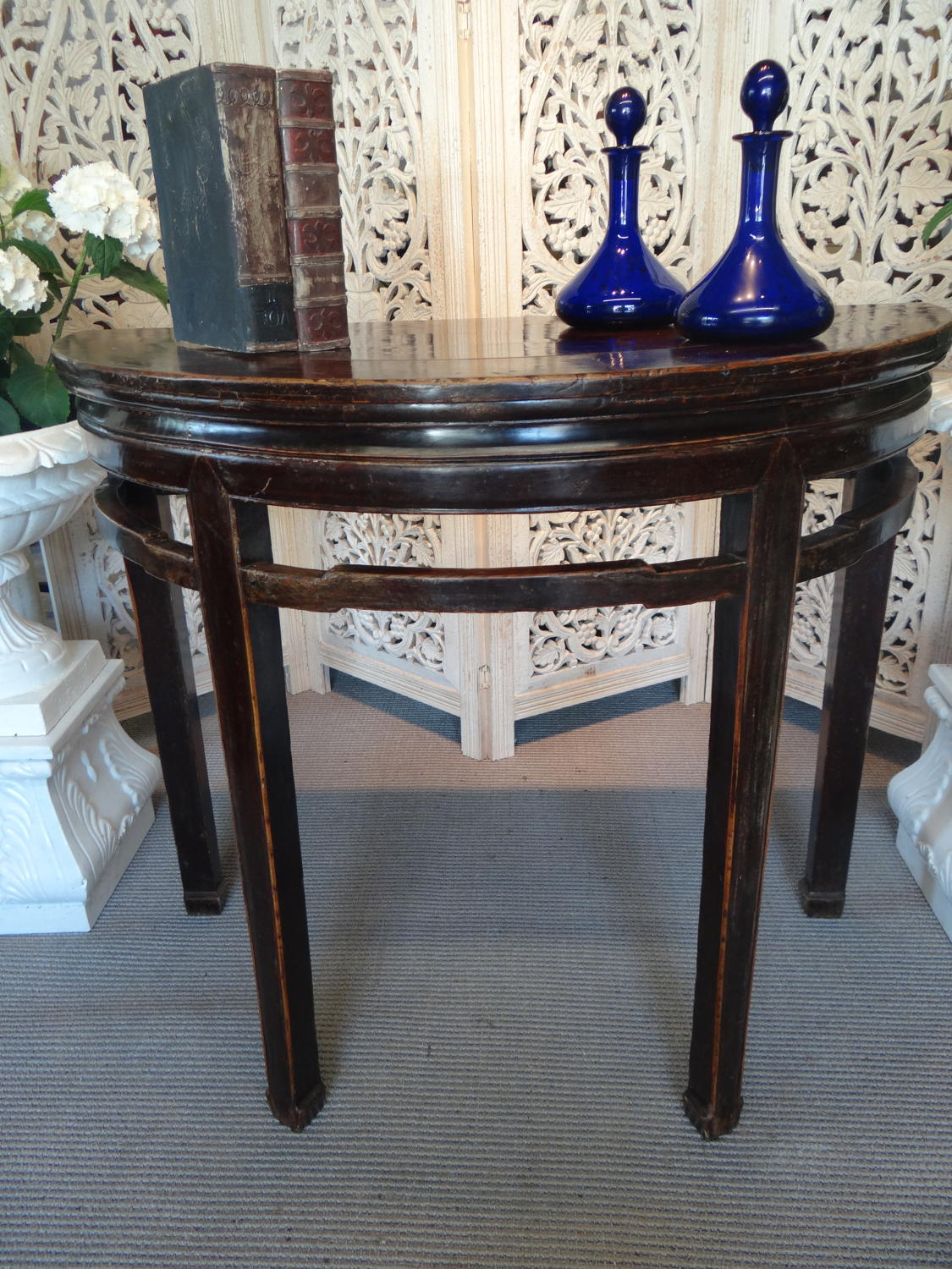 Chinese demi lune table.