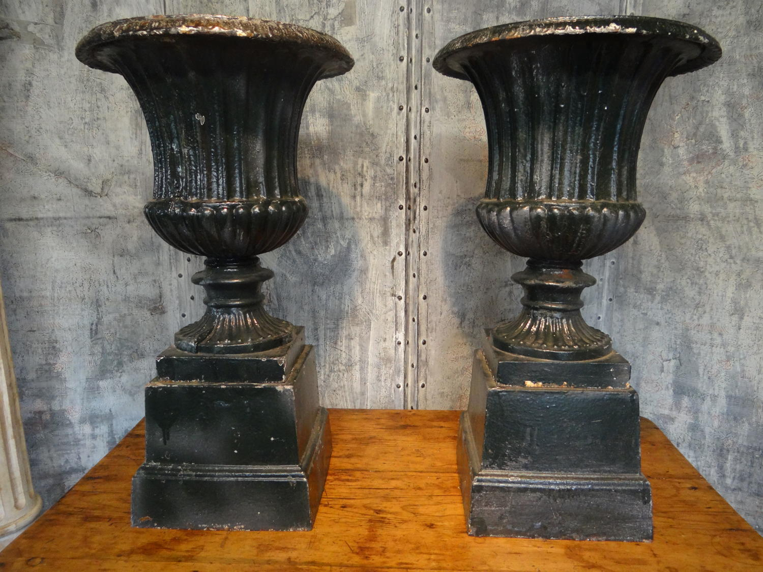 Cast iron urns on stands