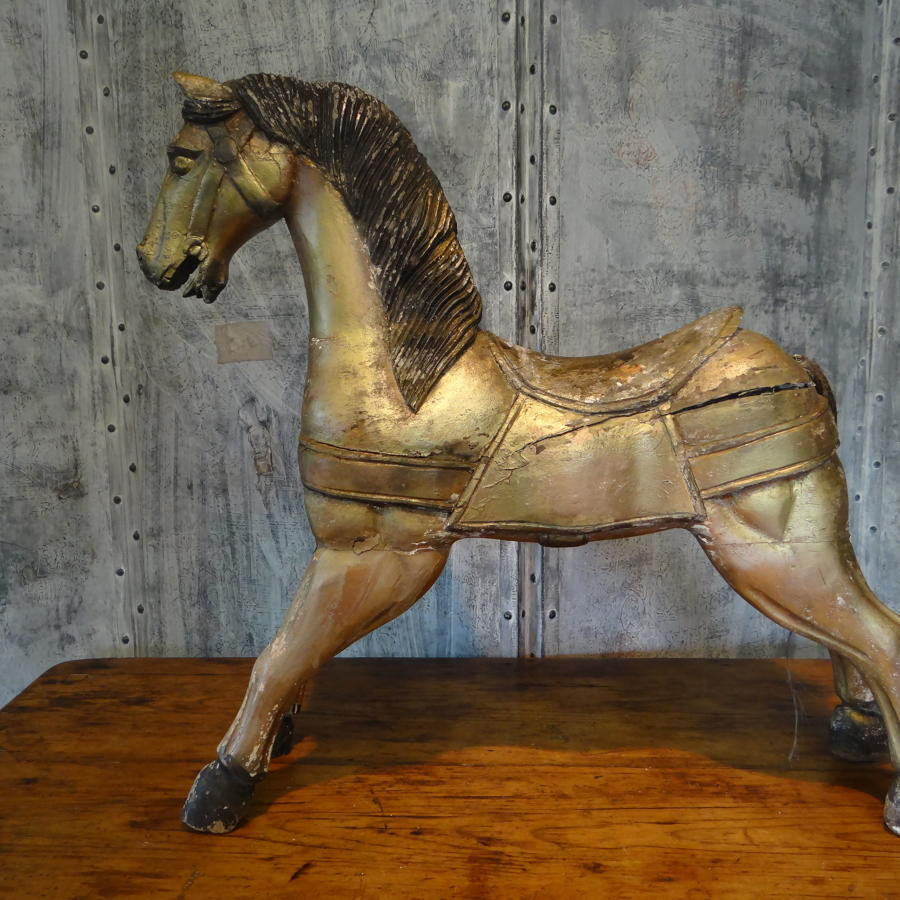 A gilded wooden horse